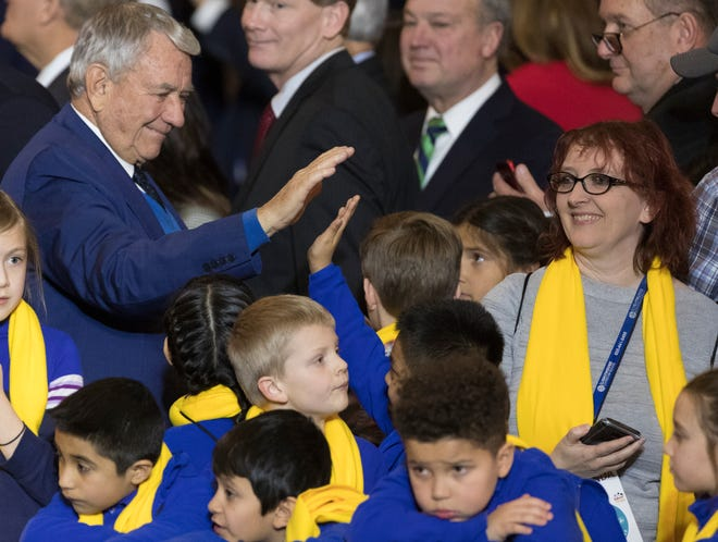 Former Gov. Tommy Thompson greets well-wishers at a rally for school choice at the Capitol.