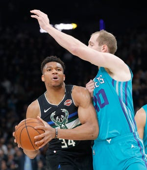 Giannis Antetokounmpo played against the Hornets on Friday in Paris and practiced Monday but will miss Tuesday's game with a sore right shoulder.