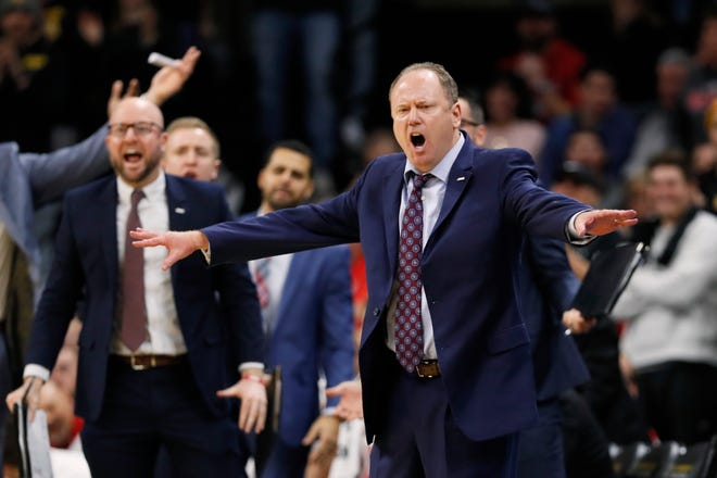 Wisconsin head coach Greg Gard reacts to a call against his team during the second half against Iowa.