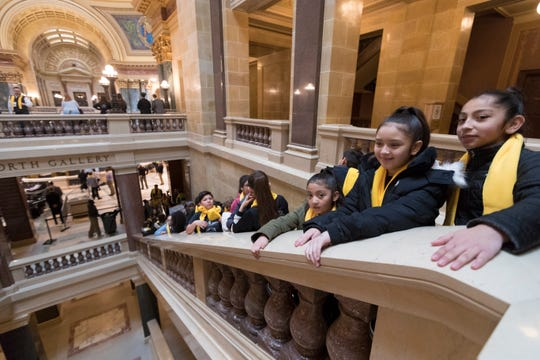 Students from Milwaukee's Dance Academy of Mexico wait for Vice President Mike Pence's appearance to promote private school vouchers and other alternatives to traditional public schools at a rally at the Capitol in Madison.
