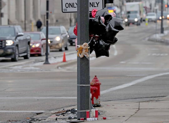 A makeshift memorial is at the site of a fatal car crash involving a Milwaukee County sheriff's squad car on Saturday near the corner of North 10th Street and West State Street in Milwaukee on Tuesday. Ceasar Stinson, a 47-year-old community advocate and Milwaukee Public Schools lobbyist, was killed in the crash.