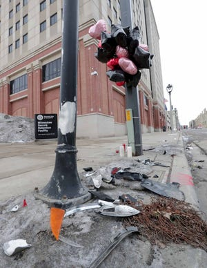 A makeshift memorial is at the site of a fatal car accident involving a Milwaukee County Sheriff's squad car on Saturday near the corner of North 10th Street and West State Street in Milwaukee on Tuesday, Jan. 28, 2020.  The man killed in the crash was identified as Ceasar Stinson, a 47-year-old community advocate and Milwaukee Public Schools lobbyist. The accident is under investigation.