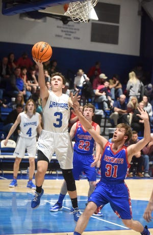 Cotter's Tucker Coots drives for a layup against Bruno-Pyatt on Monday night.