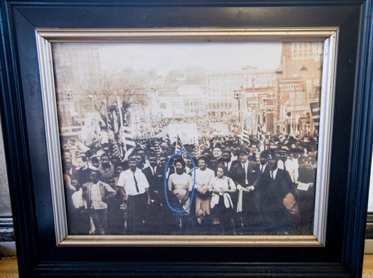 A photo of Jereline Bethune, who started Brenda's in Montgomery, Ala., walking in the Selma to Montgomery March in Montgomery.