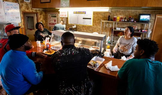 Diana Bethune, left, and Arlene Mensah, right, serve diners breakfast in Barbara Gail's, at the corner of Early St. and Oak St. in Montgomery, Ala., on Monday January 27, 2020.