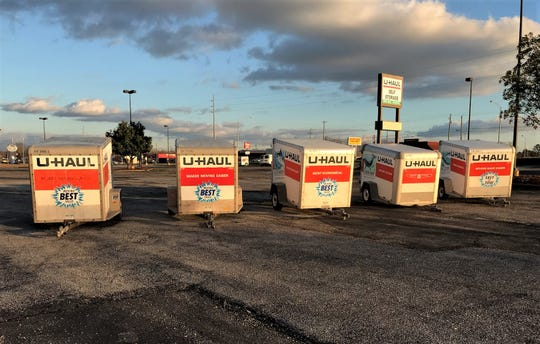 U-Haul trailers in the parking lot of the old Kmart building.