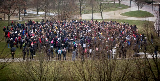 Around 200 to 300 Ball State University students and faculty gather on Jan. 28 at the University Green to demand change after a professor called the police on a student who refused to move seats in class last week.