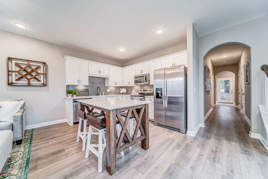 Hardwoods, stainless appliances and neutral wall colors are part of the décor of this Parkside Builders model.