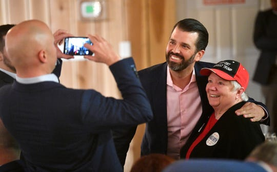 Donald Trump Jr. poses with a supporter at a fundraiser for Republican Bill Hagerty in his bid for an open U.S. Senate seat. President Donald Trump's oldest son and former Fox News personality Kimberly Guilfoyle headlined a Hagerty campaign event on Tuesday  in Gallatin, Tenn. Tuesday, Jan. 28, 2020.
