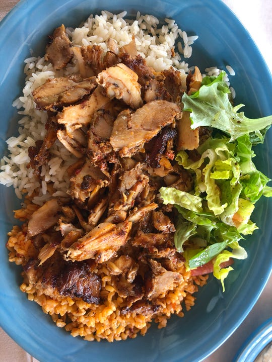 The chicken doner kebab lunch special ($15.95) from Vourla Mediterranean Grill and Cafe in Naples is served with rice and dressed greens.