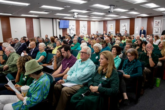 Members of the public wear green to show their support of sustainable development under the Rural Lands Stewardship Area program during the public comment portion of a Collier County Commission meeting on Tuesday, January 28, 2020.