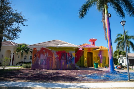 The owner of a home located at 6913 Il Regalo Circle in North Naples painted their home in vibrant colors as pictured on Tuesday, Jan. 28, 2020.