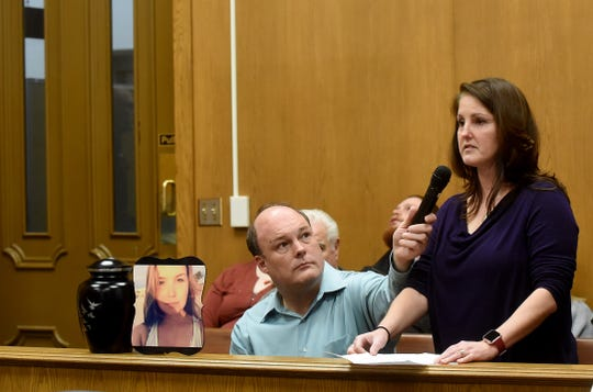 The cremated remains of Sierra Beal sit on the rail between the gallery and prosecutor's table as Licking County victim advocate Mark Weiner holds a microphone for Beal's aunt Brandi Anders as she addresses judge David Branstool in a change of plea and sentencing hearing for Kameron Skally. Anders said their grief will last a lifetime and asked the judge to impose the maximum sentence. Skally was sentenced to 28 years to life in the premeditated shooting death of his fiance, Beal.