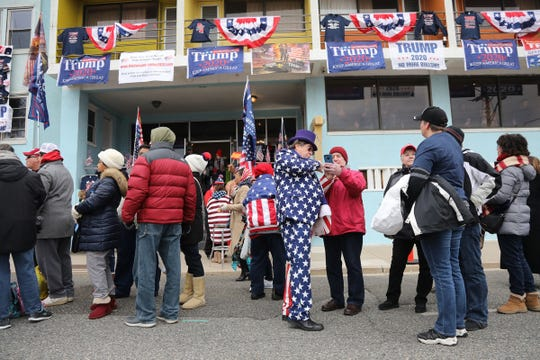 Supporters of President Trump line up on Ocean Ave. across from the Wildwood Convention Center in anticipation of getting in to see the President speak tonight.