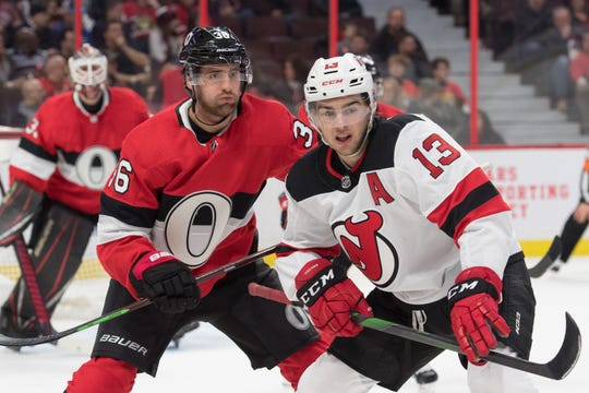 Jan 27, 2020; Ottawa, Ontario, CAN; Ottawa Senators center Colin White (36) faces off against  New Jersey Devils center Nico Hischier (13) in the first period at the Canadian Tire Centre. Mandatory Credit: Marc DesRosiers-USA TODAY Sports