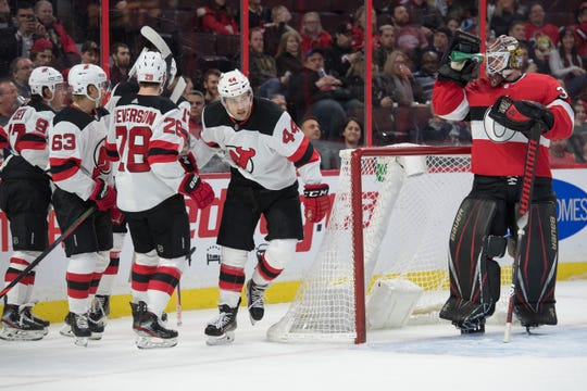 Jan 27, 2020; Ottawa, Ontario, CAN;  The New Jersey Devils celebrate a goal scored by defenseman Damon Severson (28) in the first period against the Ottawa Senators at the Canadian Tire Centre. Mandatory Credit: Marc DesRosiers-USA TODAY Sports