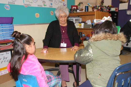 Maria Hernandez, 82, has been a Foster Grandparent in the Deming Public Schools for over 19 years. Here, she is working with two kindergarten students at Bataan Elementary School in Deming. The Foster Grandparent Program is provided through the Deming Senior Citizen's Center.