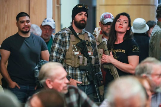 Kristin Wamle and Sam McBurney open carry at a Doña Ana County Commission discuss a resolution supporting a NM red flag bill in Las Cruces on Tuesday, Jan 28, 2020.