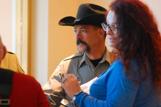 """New Mexico Sheriffs Association President Tony Mace arrives Tuesday, Jan. 28, 2020, at the New Mexico state Capitol to speak in opposition to a red-flag gun bill that would allow authorities to take guns away from people deemed dangerous to themselves or others. Democratic lawmakers and Gov. Michelle Lujan Grisham are pushing for the legislation. Hundreds of people filed into the state Senate gallery, including gun control advocates wearing """"Moms Demand Action"""" T-shirts and more than a dozen county sheriff's who are outspoken opponents of the initiative."""