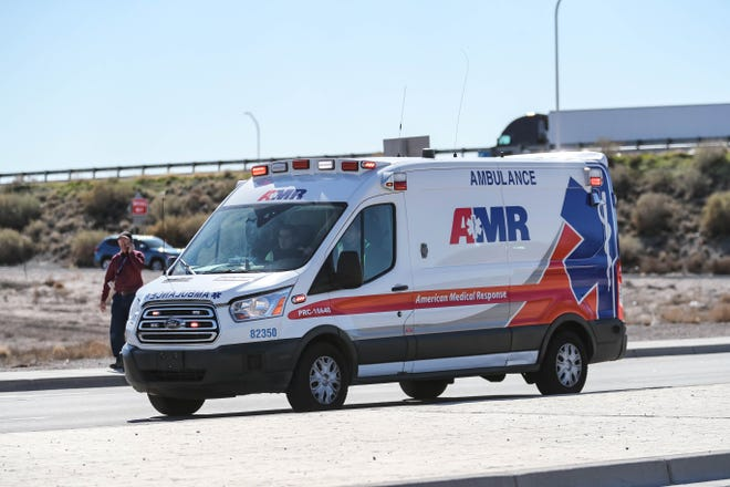 An ambulance leaves the scene after a semi truck jumped the railing off the I-10 freeway overpass on to Avenida de Mesilla in Las Cruces on Tuesday, Jan. 28, 2020.