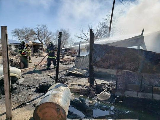 Firefighters from multiple agencies fight a fire at a mobile home in La Union, Tuesday Jan. 28, 2020.