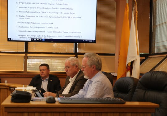 From left:District 2 Eddy County Commissioner Jon Henry, District 3 Commissioner Larry Wood and County Attorney Cas Tabor listen to a presentation during the Jan. 28 Eddy County Board of Commissioners meeting.