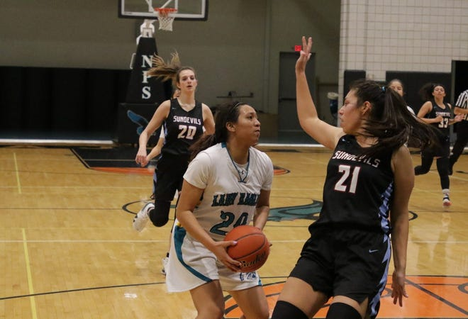 Navajo Prep's Aiona Johnson sets up a shot against Sandia Prep's Mika Juan on Friday, Jan. 10, 2020 at the Eagles Nest in Farmington. Prep is still No. 1 in the latest 3A girls basketball rankings.