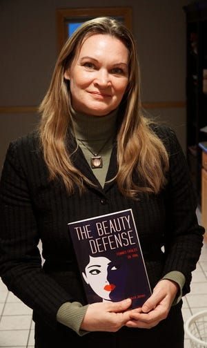Author Laura James her book The Beauty Defense.