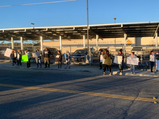 Parents and students gather along La Contenta Road to protest what they call a spike in violence at La Contenta Middle School in Yucca Valley on Tuesday, Jan. 28, 2020.