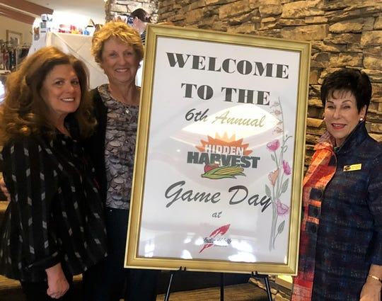 Dee Brown, president of Friends of Hidden Harvest, joins Margie Feldman and event coordinator Barbara Stenzler at the 6th annual Hidden Harvest game day.