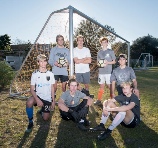 Boys soccer players (back left to right) Britton Landrum, Zach McLouth, and Luke Jacobi, (front left to right) Anthony Ciccurello, Trevor Isakson, Trey Childs, and Jayce Dotson pose at Gulf Breeze High School on Tuesday, Jan. 28, 2020.
