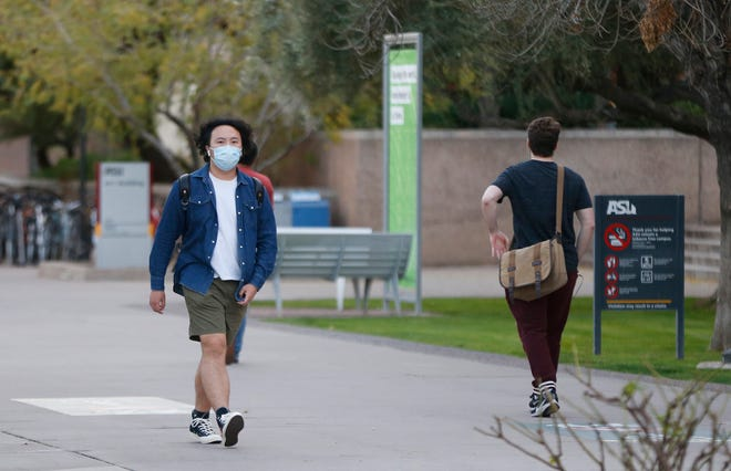Students wear masks after a confirmed case of the new coronavirus was reported on ASU's Tempe campus on Jan. 26, 2020.
