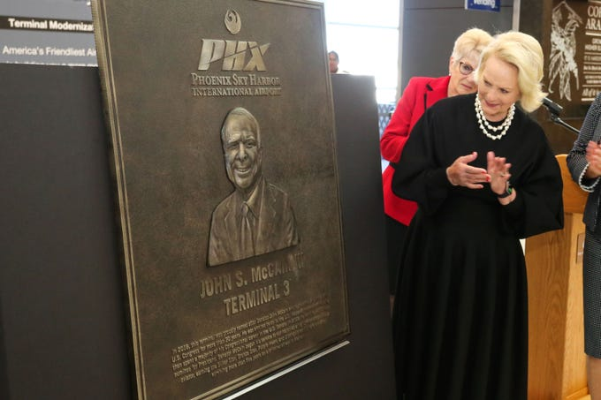 Cindy McCain gazes at a newly-fabricated plaque honoring her husband the late John S. McCain III at Phoenix Sky Harbor's Terminal 3. Terminal 3 was recently renamed the John S. McCain III Terminal 3.