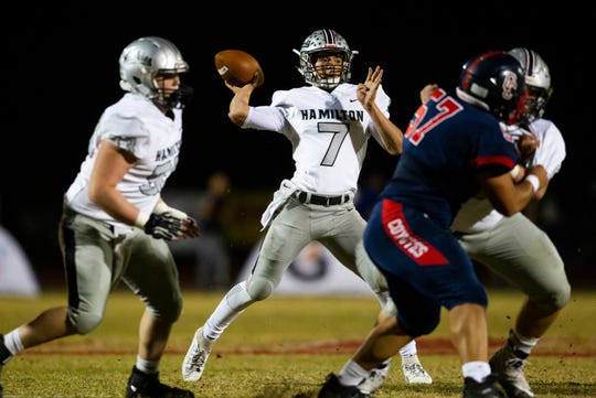 Hamilton quarterback Nick Arvay throws the ball during a high school football game between Centennial and Hamilton High Schools at Centennial High in Peoria on Friday, Nov. 15, 2019.