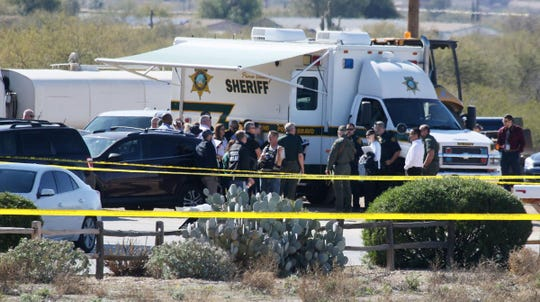 Investigators from Tucson Police and the Pima County Sheriff's Department at the scene of a shooting at a Speedway gas station on Ajo Highway at Tucson Estates Parkway on Jan. 28, 2020.
