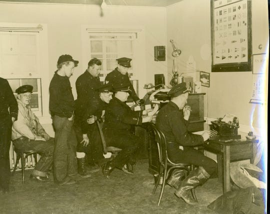 Service members work at Coast Guard Station Port Huron. The station opened in 1932 and closed in the early 2000s. It is currently being restored to its 1930s condition.