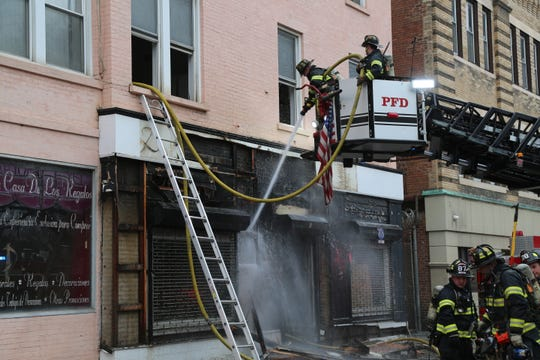 Firefighters responding to a fire at 6 Catharine Street.