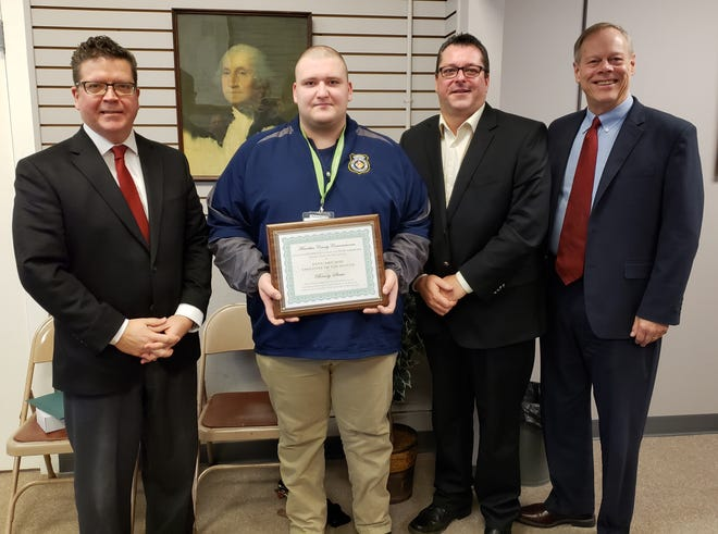 Franklin County Board of Commissioners recently recognized 911 dispatcher Brady Strite for helping a couple to deliver their baby at home before medical help could arrive. Strite, second from left, is pictured with commissioners Dave Keller, John Flannery and Bob Ziobrowski.