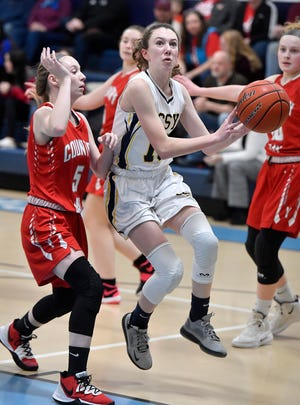 Kayleigh Rhine of Christian School of York drives the lane while covered by Karrington Brown of York Country Day, Monday, January 26, 2020.John A. Pavoncello photo