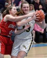 Christian School of York's Emma Bell, seen at right in a file photo, had 19 points and 21 rebounds on Saturday night in the Defenders' win over Mount Calvary Christian in the Commonwealth Christian Athletic Conference girls' basketball title game.