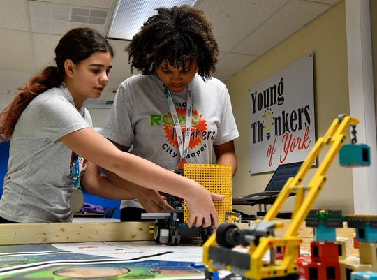 Cheyenne Minichino, 12 left, and Jahziah Ford, 12, of the RoboThinkers youth robotics team set up their robot for a run,  Monday, January 26, 2020. The team recently placed first place in Programming and fifth in points during the Robot Games in Reading.John A. Pavoncello photo
