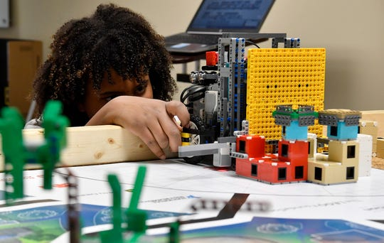 Jahziah Ford, 12, of the RoboThinkers youth robotics team set up the team robot for a run,  Monday, January 26, 2020. The team recently placed first place in Programming and fifth in points during the Robot Games in Reading.John A. Pavoncello photo