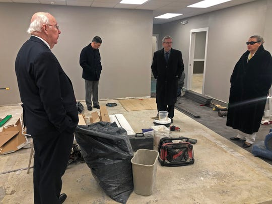 The Wayne County commissioners (Ken Paust, left; Denny Burns, second from right; and Mary Anne Butters, right) and Steve Higinbotham, the county's director of facilities and development, tour the soon-to-be new home of the Wayne County Health Department on Wednesday, Jan. 22, 2020.
