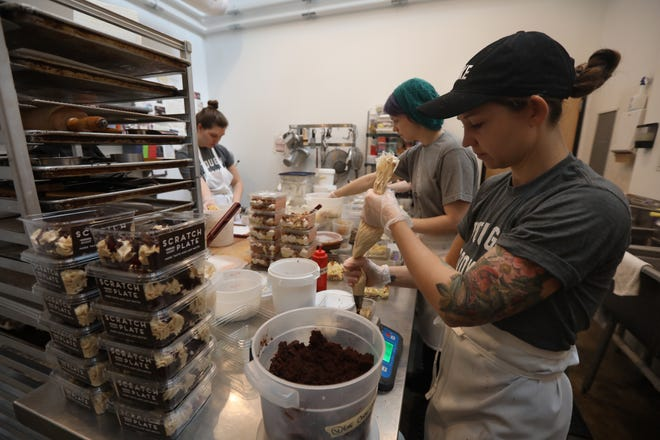 Molly Hartley, one of the owners of Scratch Bakeshop, works in the kitchen.  She along with Maddie LaCava and Bonnie Hodul, and unseen, co-owner, Jen McClure, were making four different Scratch Plates.