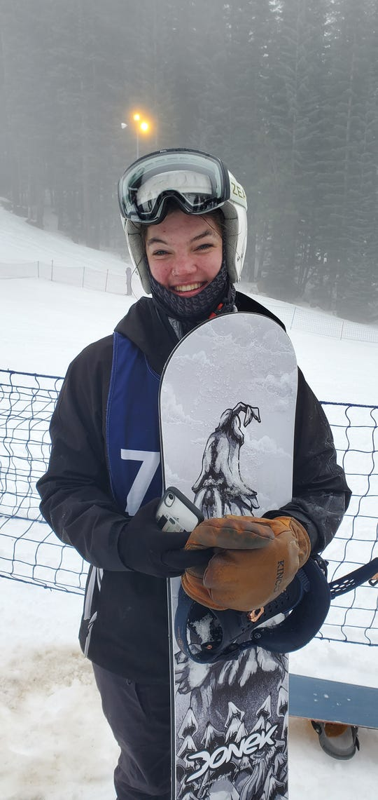 Mount Shasta High School snowboarder Tate Harkness holds her snowboard at Mt. Shasta Ski Park on Monday,  Jan. 27, 2020.