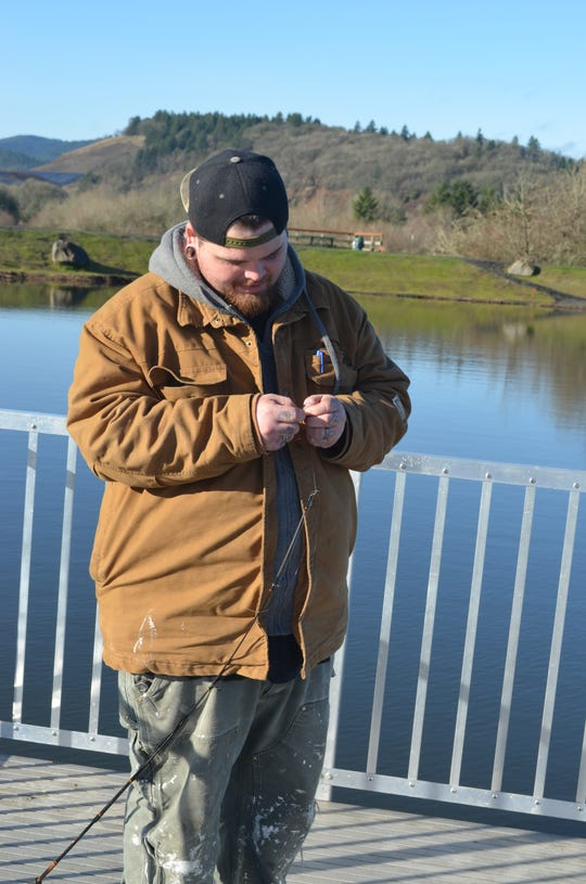Richard Hubbard of Monmouth rigs up on one of the new fishing platforms at E.E. Wilson Pond.