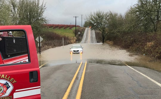 A car stuck in high water across SW Bellevue Highway on Tuesday, Jan. 28.