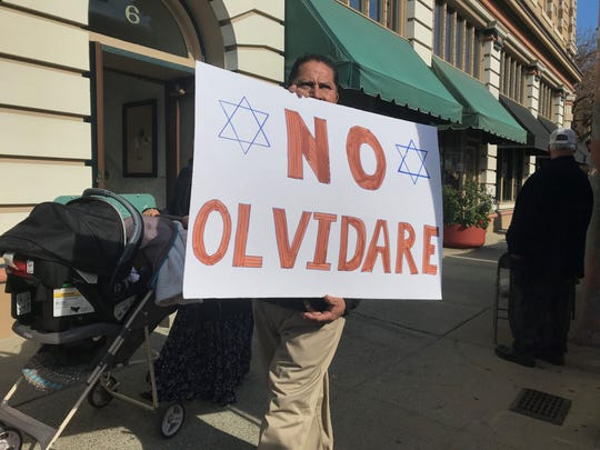 "A man holds up a sign saying ""No Olvidare"" (I won't forget) as part of the Holocaust Remembrance Walk in Salinas Jan. 25, 2020."