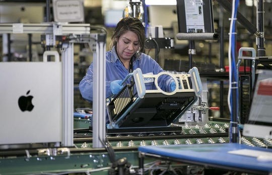 An employee assembles an Apple Mac Pro computer at the Flextronics America factory in Austin late last year. Factory output in Texas appears to be perking up, according to the latest survey of the sector by the Federal Reserve Bank of Dallas.