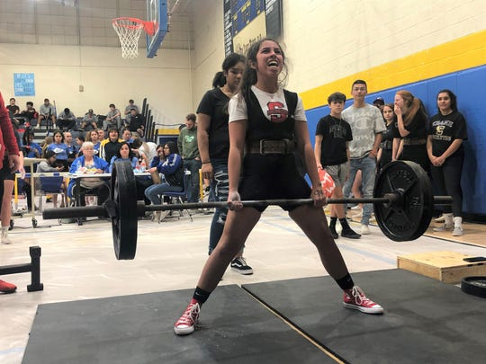A Sonora powerlifter pulls her deadlift off the ground during the Big Lake Invitational Powerlifting meet on Jan. 25, 2020.